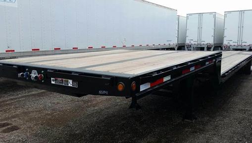 Image from: https://www.mylittlesalesman.com/2020-demco-53x102-tandem-axle-steel-drop-deck-trailer-air-ride-fixed-spread-axle-9895867